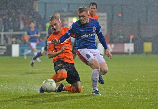 Linfield's Shayne Lavery and Carrick's Chris Rodgers