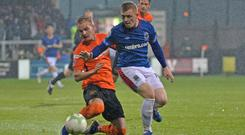 Closing the gap: Linfield's Shayne Lavery and Carrick's Chris Rodgers