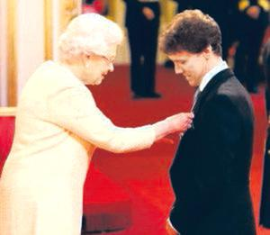 Emotional day: Noel is given his MBE by the Queen