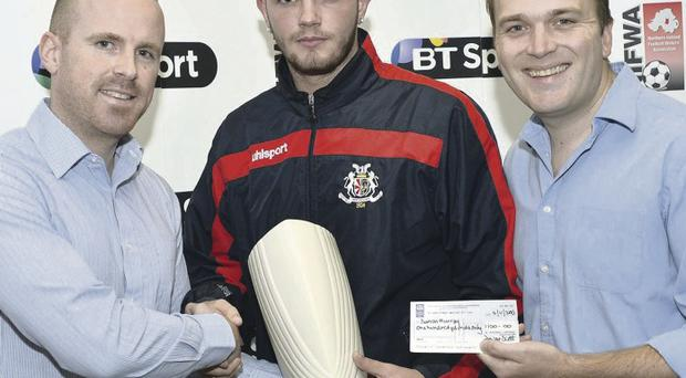 Player of the month Darren Murray receives his prize from Sunday Life's Paul Ferguson (right) and Paul Lavery from BT