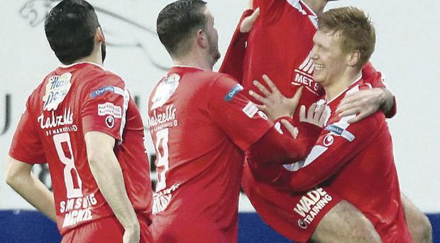 Sean Mackle, Darren Murray and Chris Casement celebrate with Portadown's opening scorer Chris Ramsey