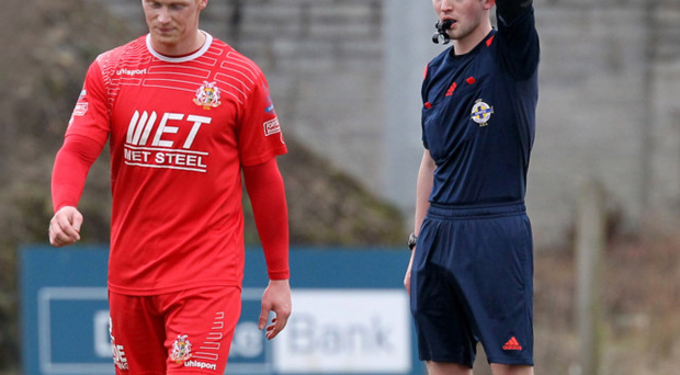 Seeing red: Chris Casement sent off against Dungannon