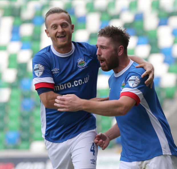On course: Sammy Clingan and scorer Mark Stafford enjoy the moment as Linfield go two up