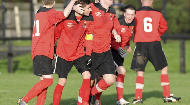 Taking the plaudits: Bryansburn Rangers ace Stewart Morrison is surrounded by team-mates after finding the net