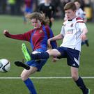The day's only female competitor, Lennon McKeeman of Dalriada, battles with Lurgan Junior High School's Lewis Kennedy in the Intermediate U14 Plate clash