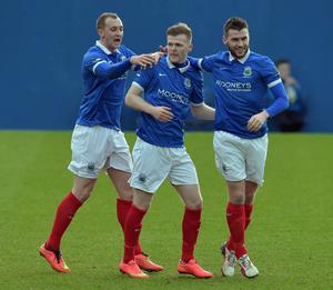 Ross Clarke (centre) was on target in Linfield's defeat of Warrenpoint Town