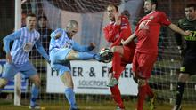 Block party: Warrenpoint striker Stephen Hughes sees a strike charged down by Ross Redman and Michael Gault