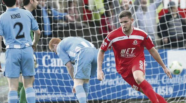 All square: Portadown striker Darren Murray wheels away after firing his side level at Stangmore Park