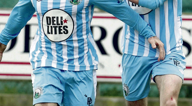 On the up: Warrenpoint's Stephen Hughes celebrates his goal against Cliftonville, although it was short-lived as the champions equalised