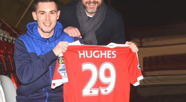 Done deal: all smiles as Cliftonville boss Gerard Lyttle welcomes Warrenpoint Town striker Daniel Hughes to Solitude