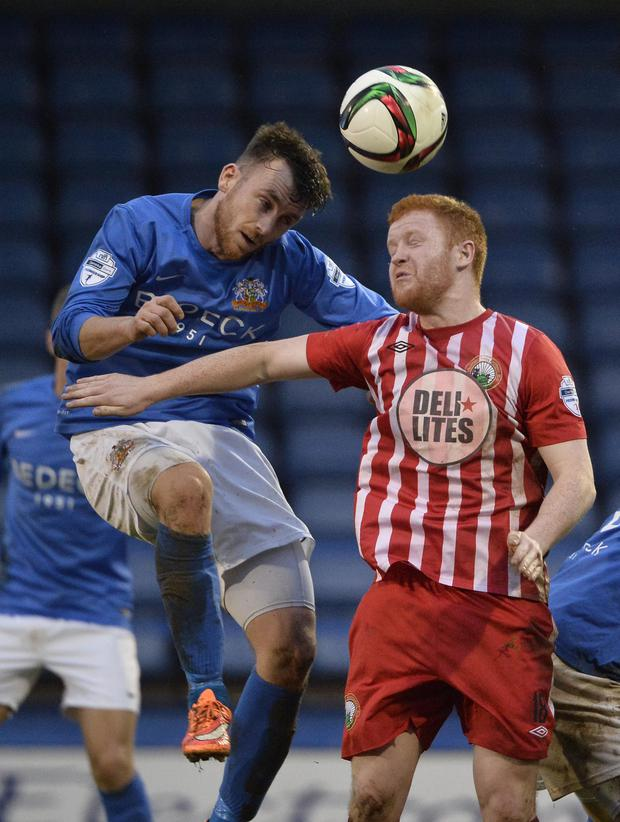 Heads up: Glenavon's Conor Dillon with Stephen Moan