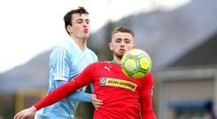 Control: Rory Donnelly comes under pressure from Danny Wallace