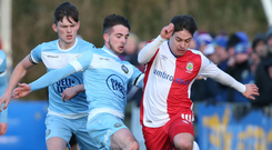 Forward motion: Jordan Stewart gets the better of Warrenpoint's Conall Young