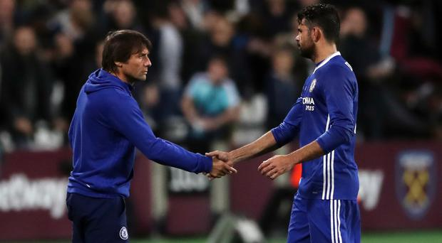 Diego Costa (right) claims Antonio Conte told him he was surplus to requirements at Chelsea by text message