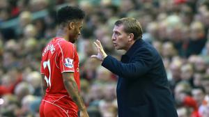 Liverpool manager Brendan Rodgers, right, is relaxed about Raheem Sterling's contract negotiations