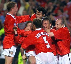 Ole Gunnar Solskjaer is mobbed by teammates after scoring a last second winner in the Champions League final (Owen Humphreys/PA)