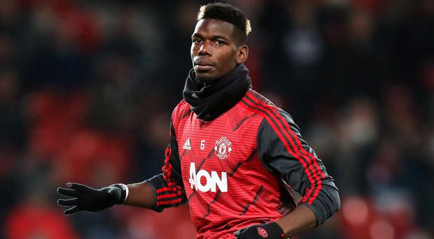 Paul Pogba wore anti-racism wristbands during the warm-up on Boxing Day (Martin Rickett/PA)