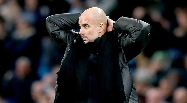 Pep Guardiola looks on during Saturday's derby defeat and knows the game is up (Martin Rickett/PA)