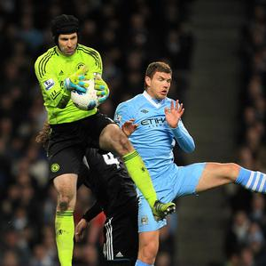 Edin Dzeko, right, scored a brace as Manchester City fought back to defeat Chelsea in a friendly