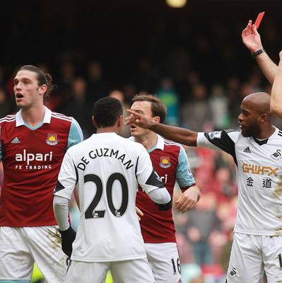 Andy Carroll, left, was sent off after a challenge with Swansea's Chico Flores