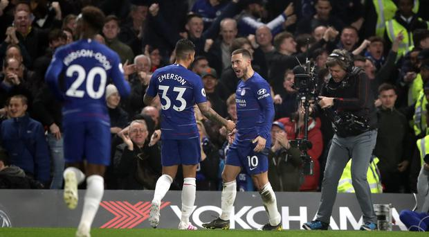 Chelsea's Eden Hazard (right) celebrates scoring his side's first goal of the game with Emerson Palmieri during the Premier League match at Stamford Bridge, London.