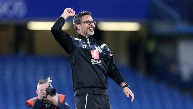 David Wagner, pictured celebrating Premier League survival, has committed himself to Huddersfield (Steven Paston/EMPICS)