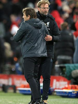 Klopp goes up against Antonio Conte (left) on Sunday