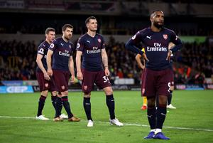 Arsenal's Laurent Koscielny, Sokratis Papastathopoulos, Granit Xhaka and Alexandre Lacazette stand dejected at full-time (Nick Potts/PA)
