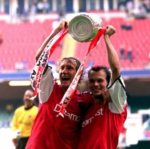 Arsenal's Ray Parlour and Fredrik Ljungberg celebrates with the cup