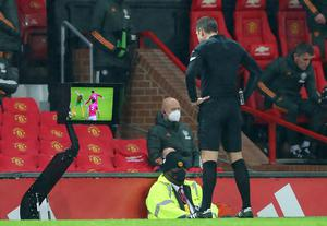 David Coote consults the VAR before overturning his decision (Alex Livesey/PA)