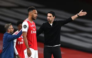 Mikel Arteta, right, believes patience will be required when the process of fans returning to football grounds begins (Shaun Botterill//PA)