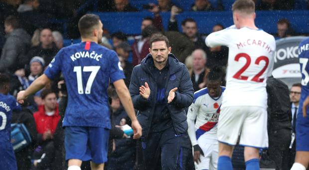 Frank Lampard, centre, applauds his team after victory over Crystal Palace (Yui Mok/PA)