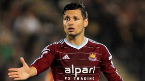 West Ham United's Mauro Zarate has rubbished claims he wants to leave the club