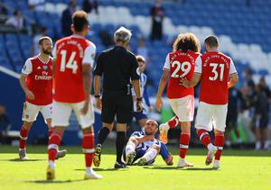 Brighton striker Neal Maupay clutches his neck after falling to the ground following an altercation with fellow Frenchman Matteo Guendouzi. The compatriots clashed during Albion's last-gasp 2-1 win over Arsenal on the first weekend after football resumed. Gunners midfielder Guendouzi has not appeared for the club since (Richard Heathcote/PA)