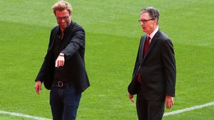 Liverpool manager Jurgen Klopp, left, insists he and principal owner John W Henry are on the same page with the club's transfer policy (Peter Byrne/PA)
