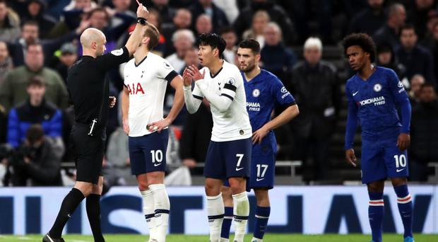 Son Heung-min, centre, was sent off for kicking Antonio Rudiger (Nick Potts/PA)