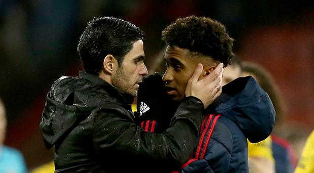 Arsenal's manager Mikel Arteta (left) with Reiss Nelson (right) (Mark Kerton/PA)