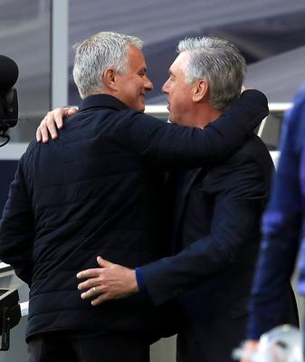 Jose Mourinho, left, hugs Carlo Ancelotti, right, at Tottenham (Adam Davy/NMC Pool/PA)