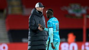 A frustrated Jurgen Klopp, left, consoles Sadio Mane after defeat to Southampton (Adam Davy/PA)
