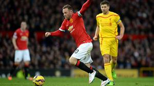 Wayne Rooney, centre, scores Manchester United's first goal against Liverpool