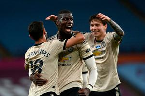 Victory roar: Manchester United goalscorer Paul Pogba celebrates with Bruno Fernandes and Victor Lindelof
