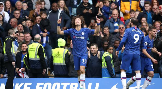 Chelsea's David Luiz celebrates scoring his side's second goal of the game during the Premier League match at Stamford Bridge, London.