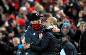 Liverpool took a major step towards a first title in 30 years by beating reigning champions Manchester City 3-1 in November. Jurgen Klopp, left, celebrated victory over Pep Guardiola thanks to goals from Fabinho, Mohamed Salah and Sadio Mane (Peter Byrne/PA)
