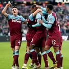 Declan Rice, right, celebrates West Ham's goal against Everton (Yui MokPA)