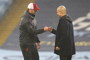Guardiola (right) has been surprised by comments from Klopp (left) (Martin Rickett/PA)
