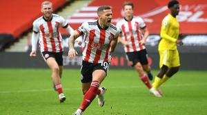 Substitute Billy Sharp celebrates scoring a late Sheffield United equaliser from the penalty spot against Fulham (PA)