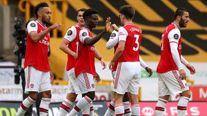 Bukayo Saka, centre, inspired victory at Wolves (Catherine Ivill/NMC Pool/PA)