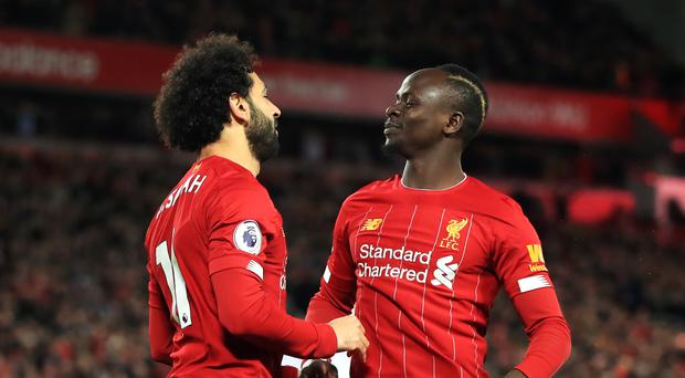 Liverpool's Mo Salah (left) celebrates scoring his side's first goal of the game with Sadio Mane (Peter Byrne/PA)