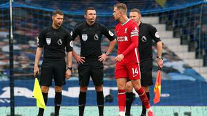 Liverpool captain Jordan Henderson speaks to referee Michael Oliver after the match (Catherine Ivill/PA)
