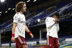 David Luiz and Joe Willock leave the pitch at Everton – where Arsenal lost for the fifth time in their last seven Premier League games (Clive Brunskill/PA)